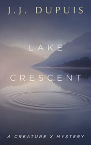 Pale bluish purple cover of a lake with mountains in the background. In white, all caps text are: J.J. Dupuis, Lake Crescent, A Creature X Mystery.